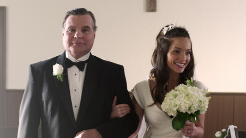Shot in front of a father and bride walking down the aisle Footage