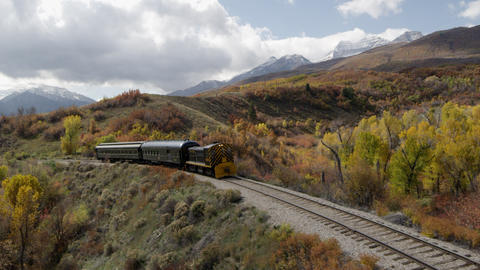 Train Rolling through Scenic Landscape Footage