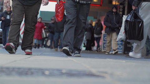 Low angle sidewalk view of people in New York City Footage
