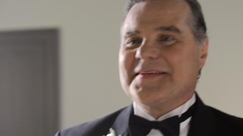Father's face as he escorts his daughter down the aisle at her wedding Footage