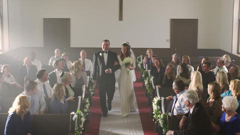 Bride smiling at the front of a chapel despite her missing groom Footage