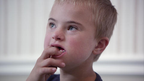 Close up of a young downs syndrome boy's face Footage