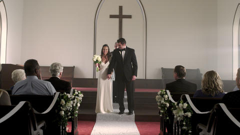 Newlywed couple kisses and walks down the aisle Footage