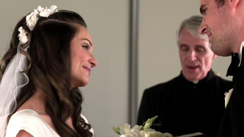 Bride and groom kiss and smile at their wedding ceremony Footage