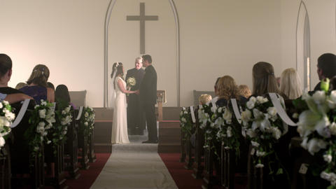 Newlywed couple walking down the aisle amid applause Footage