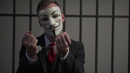 Sighing Anonymous hacker in prison Footage