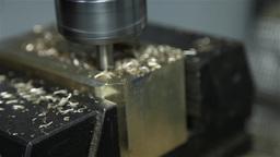 brass being drilled by industrial drill, slider shot Footage