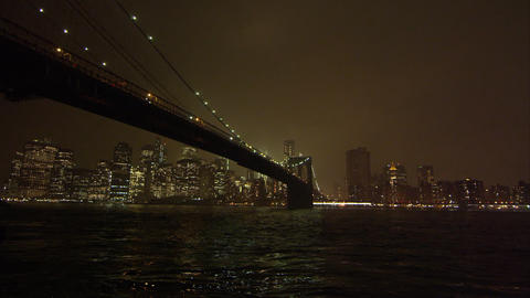 Static view at night overlooking the East River and the Brooklyn Bridge Footage