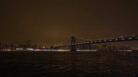 Static view at night overlooking the East River and the Manhattan Bridge Footage