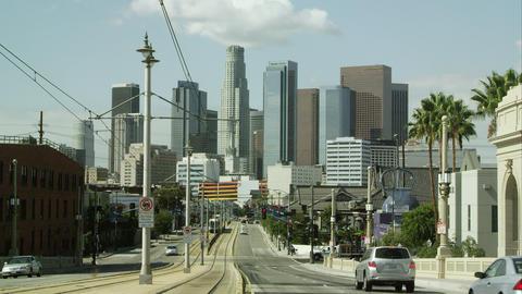 Static shot of city street looking toward skyscrapers in Los Angeles Footage
