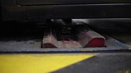 car entering vehicle inspection center, slider shot Footage
