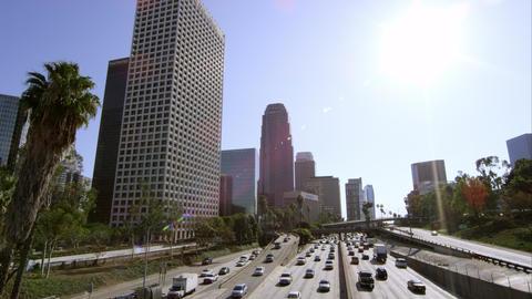 Wide pan of sky scrapers and traffic from bridge in Los Angeles Footage