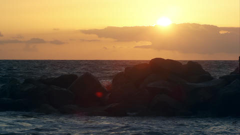 Slow motion view of waves crashing on rocks at sunset on Venice Beach Footage