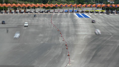 Traffic in a toll.Time Lapse. Long exposure.Top view Live Action