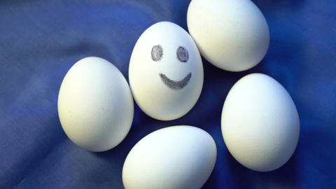 Pile of eggs, one smiling, different, standing out from... Stock Video Footage