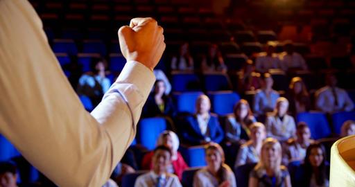 Businessman speaking in business seminar on stage in auditorium 4k Live Action