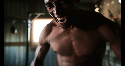 African American aggressive male boxer standing in fitness studio 4k Live Action