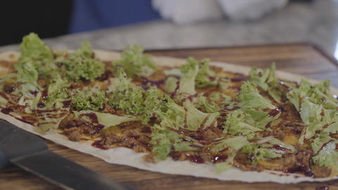 Close up of lettuce leaves lying over pita with bbq sauce. Turkish cuisine Footage