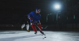 Two man playing hockey on ice rink. hockey Two hockey players fighting for puck Footage