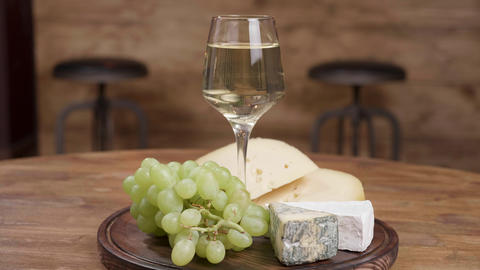 A beautiful glass of wine served with grapes and cheeses ライブ動画