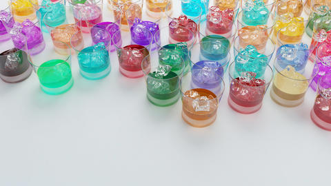 Multi color drink glasses with ice フォト