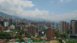 Climbing aerial drone view of Medellin city in Colombia with high buildings and the mountains Footage