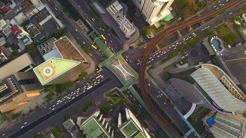 Time lapse of aerial view of Sathorn intersection or junction with cars traffic, Bangkok Downtown, Footage