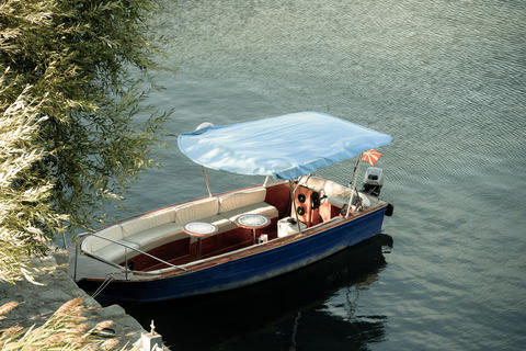 Boat anchored on Ohrid's Lake. Small boat on a lake in Ohrid. Boat in a port Photo