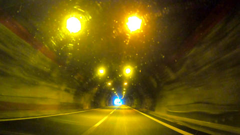 Driving The Car In A Small Illuminated Tunnel