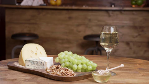 Food art concept of a glass of white wine and cheese appetizer ライブ動画