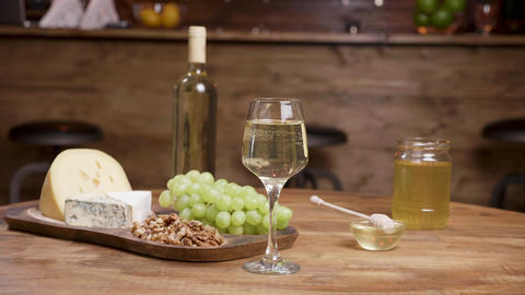 A bottle and a glass of wine combined with cheeses ライブ動画