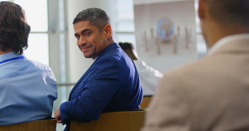 Businessman sitting and smiling in the business seminar 4k Live Action