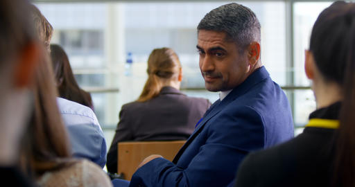 Businessman sitting in the business seminar 4k Live Action