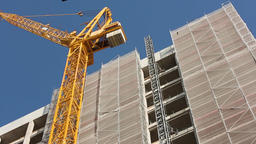Construction Crane and Building Scaffold Live Action