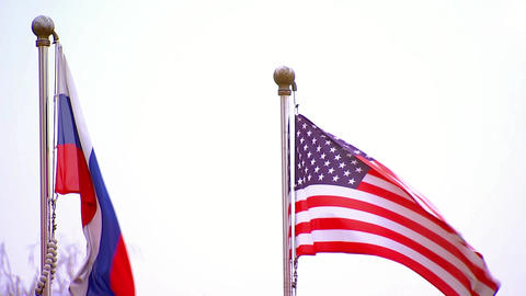 American and Russian flags fluttering, the Commonwealth and the confrontation Footage