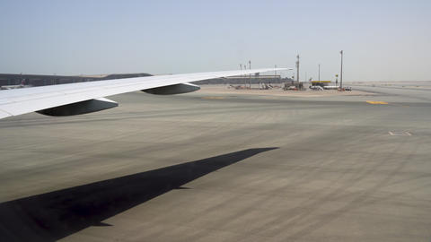 A huge area of the airport in a hot sunny country. Heaven and earth merge on the Footage