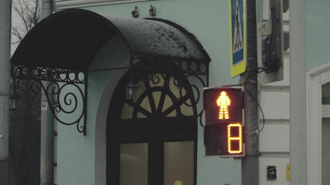 Pedestrian traffic lights on the street with a countdown timer Archivo