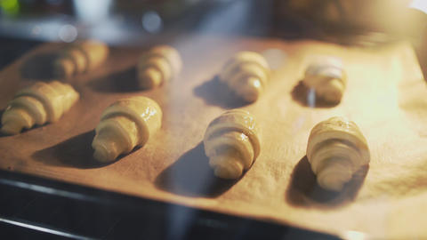 Time-lapse video of croissants baking in oven Live Action