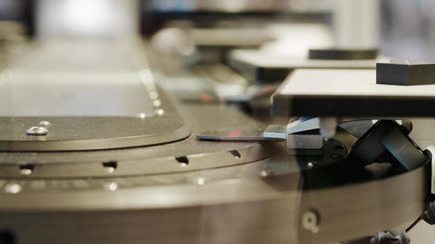 Details on moving high speed conveyor belt under scanner Footage