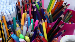 color pencils and pens in plastic cups Footage