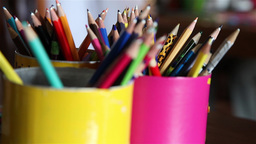 Focus defocus of several colored pencils in cans Footage