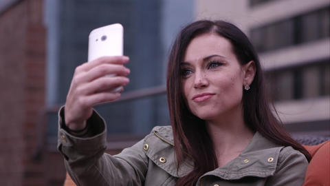 Woman taking picture of herself with smartphone Footage