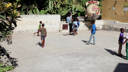 African boys playing football in the school playground in cape verde africa Footage