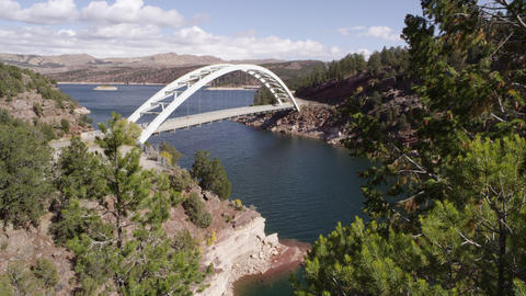 Slow pan from right to left of Cart Creek Bridge at Flaming Gorge in Utah Footage