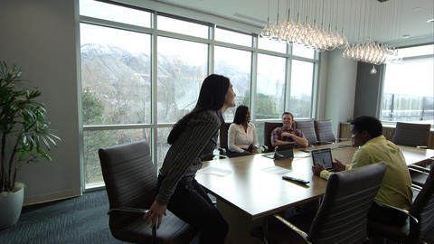 Woman walking into conference room Footage