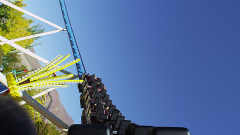 Shot of a rollercoaster car as it either returns, or begins it's take off Footage