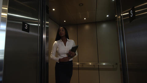 Elevator door opens and woman walks out Footage