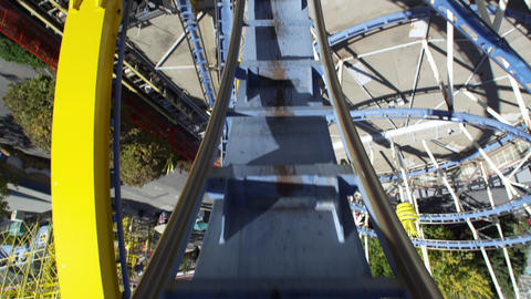 First person view of a roller coaster going up backwards a loop Footage