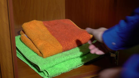 Taking a set of towels from a wardrobe Footage