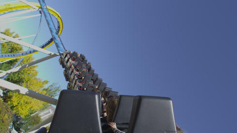 Shot from the back of a rollercoaster riding the twists and turns of the track Footage